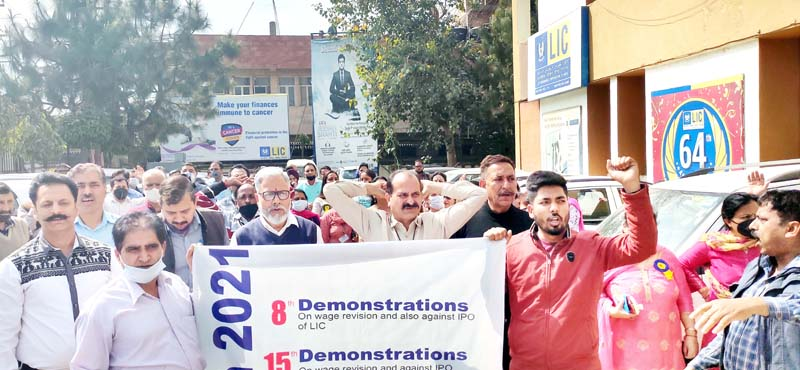 LIC employees protesting in Jammu on Monday.