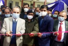 Justice Ali Mohd Magrey inaugurating Mega Legal Service camp at Anantnag.