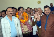 Romesh Chander Gupta with sign of victory after his election as president of Central Mahajan Sabha on Sunday.