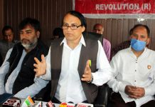 Govt Employees Joint Action Committee-R leader, Babu Hussain Malik addressing press conference in Jammu. -Excelsior/Rakesh