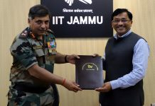 Lt Gen S Harimohan Iyer and Prof Manoj Singh Gaur displaying copy of MoU signed between Northern Command & IIT Jammu.