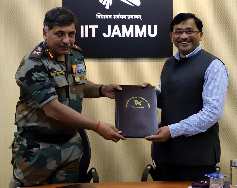 Lt Gen S Harimohan Iyer and Prof Manoj Singh Gaur displaying copy of MoU signed between Northern Command & IIT Jammu.