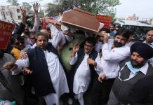 Cong leaders taking out funeral procession over fuel price hike by Modi Govt in Jammu on Saturday. —Excelsior/Rakesh
