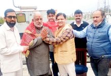Swami Vishwa Nathan, North Regional Head Saksham being honoured during a function at Udhampur on Sunday.
