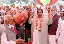 Former Minister Raman Bhalla, flanked by Ex-MLC Balbir Singh & Ex-MLA G L Chalotra leading protest of Cong party in Hiranagar on Friday.