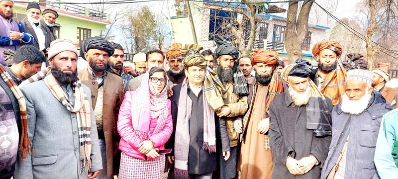 Noted tribal researcher Javaid Rahi posing with tribals after an awareness programme in Jammu.