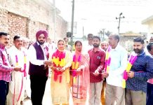 DDC member from Suchetgarh Taranjit Singh Tony and others starting road construction work.
