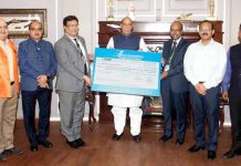 Defence Minister Rajnath Singh receiving interim dividend from Chairman & Managing Director of Bharat Electronics Limited M V Gowtama in New Delhi on Monday. (UNI)