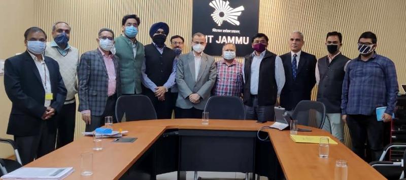 DoT officers posing with Director IIT Jammu Prof Manoj Singh after a seminar.