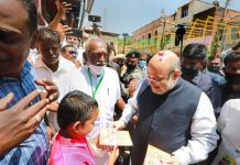 Union Home Minister and senior BJP leader Amit Shah meets supporters at the launch of Bharatiya Janata Party's (BJP's) Vetri Kodi Eandhi, a door-to-door campaign for Tamil Nadu Assembly elections, at Suchindram, Kanyakumari.