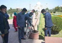 Security personnel with a sniffer dog check for bombs in the premises of the historic Taj Mahal, in Agra.