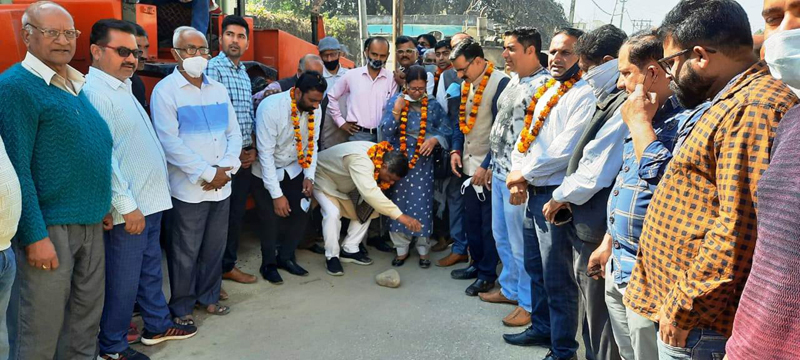 Former state president, BJP, Sat Sharma kick starting blacktopping of road in Talab Tillo area on Friday.