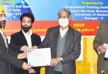 KU VC presenting certificates to NSS programme officers during valedictory function of a training programme.