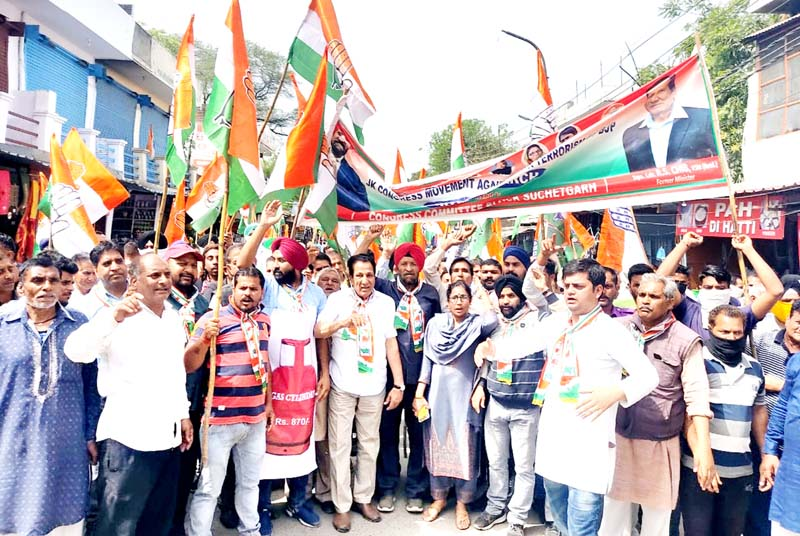 Cong activists taking out protest rally at R S Pura.