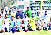 Winning team posing for a group photograph at TRC Ground Srinagar on Thursday.