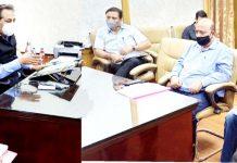 Advisor Baseer Khan chairing a meeting on Monday.