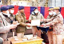 DIG Leh-Kargil Range BS Tuti and SSP Leh Rajiv Pandey presenting best Police Station Award to cops of Police Station Leh.