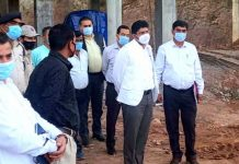 Div Com inspecting a project in Sunderbani.