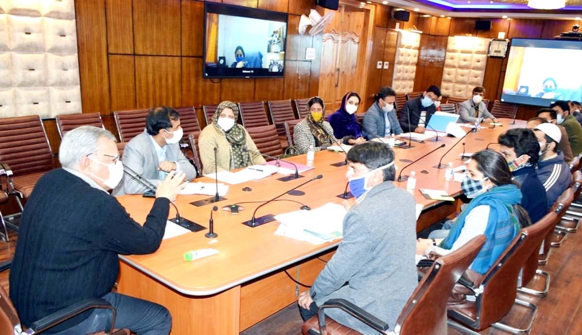Advisor Farooq Khan chairing a meeting on Monday.