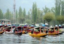 Shikara boats during rally in Dal lake Sringar on Wednesday. -Excelsior/Shakeel