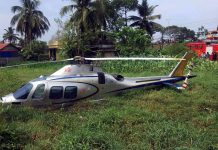 The helicopter in which UAE based Kerala business person MA Yusuff Ali and his Wife were travelling had an emergency landing on a marshy land at Panangad in Kochi on Sunday. (UNI)