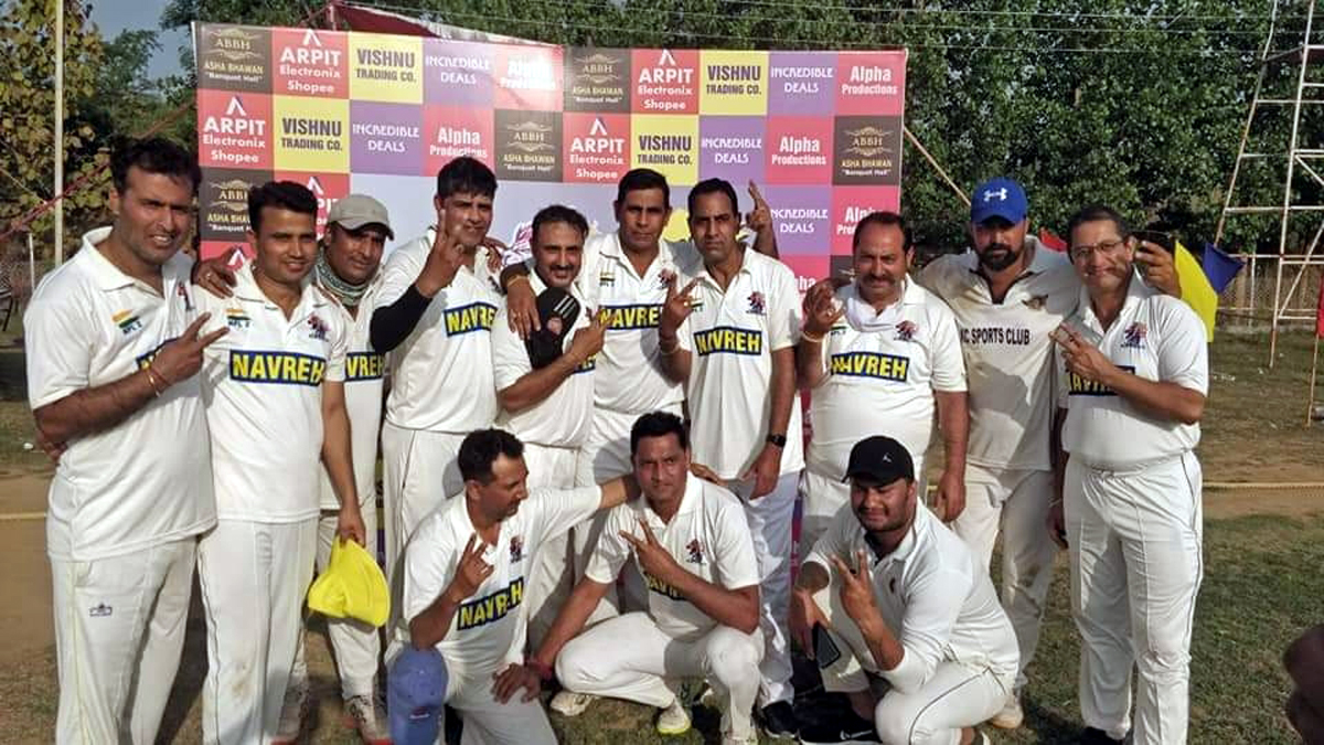 Winning team players posing for group photograph.