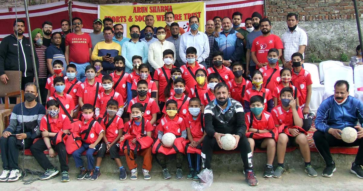 Budding handball players posing with former International players and coaches.