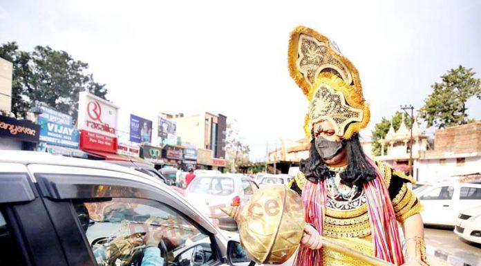 A boy dressed as Yamraj generates awareness about Coronavirus at Gandhi Nagar, Jammu. -Excelsior/Rakesh