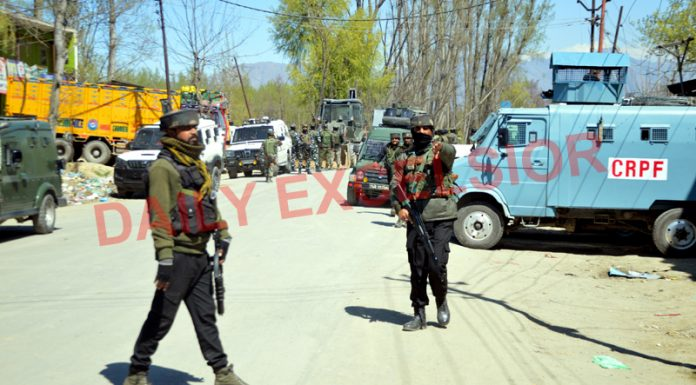 Security forces near the site of encounter at Pulwama on Friday. — Excelsior/Younis Khaliq
