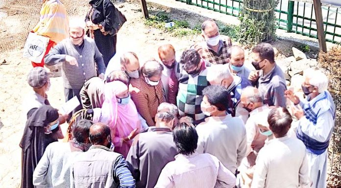 People waiting for vaccination at a health facility in Srinagar on Thursday. -Excelsior/Shakeel