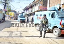 Security forces near encounter site at Jan Mohalla in Shopian on Friday. -Excelsior/Younis Khaliq