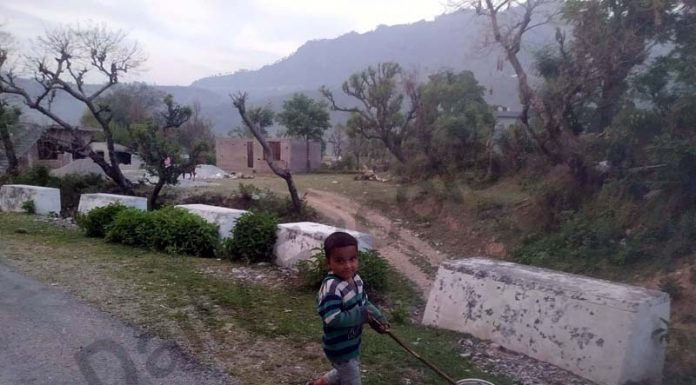 A kid enjoys himself on the outskirts of Reasi. -Excelsior/Romesh Mengi