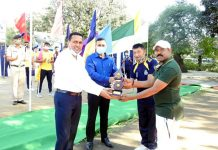IGP CRPF Jammu Sector PS Ranpise and DIG Dhirendra Verma presenting trophy to a winner at Samba.