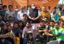 Winning team posing for group photograph with NC provincial president Devender Singh Rana at Panjgrian Nagrota on Wednesday.