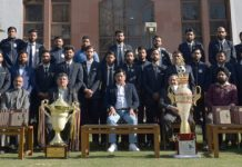 Winning Football team of J&K Bank posing for a group photograph with CMD, RK Chhibber and others at Srinagar on Friday.