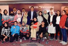 J&K medals winners posing for a group photograph along with Sports Minister during a function at Srinagar on Friday.