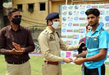 Chief guest presenting man of the match award to a player at Jammu.