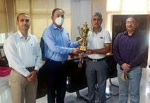 Dr S D Singh Jamwal, Additional Director General of Police felicitated Inspector Rajesh Anand of Security Pool Jammu for clinching Gold medal