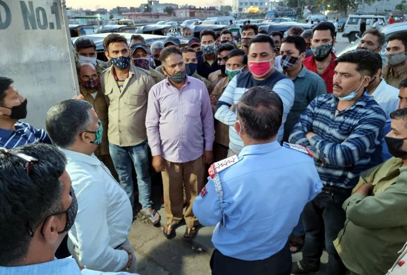ARTO Reasi Rajesh Gupta guiding the vehicle operators in Reasi on Thursday.