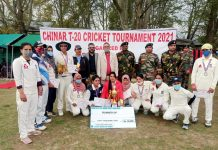 Winning team posing for group photograph with trophy along with dignitaries of the event at Ganderbal.