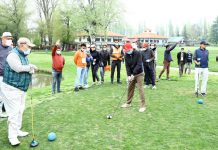 A golfer playing a shot at Royal Spring Golf Course Srinagar on Tuesday.