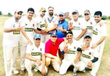 Winners posing for a group photograph after the match at Jammu on Monday.
