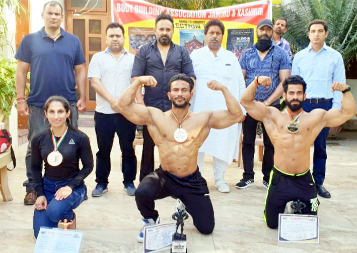 Winners posing a group photograph with chairman of the Association Raman Bhalla and others at Jammu.