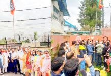 BJP leaders hoisting party flag at Jammu (L) and Srinagar (R) on Tuesday.