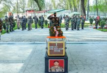 Army officers paying homage to Havildar Mohammad Saleem Akhoon in Anantnag on Saturday.