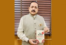 "Union Minister Dr Jitendra Singh displaying a medically documented book on India's Fight against COVID, while participating in a Virtual discussion on the occasion of ""Teeka Utsav"", on Sunday."