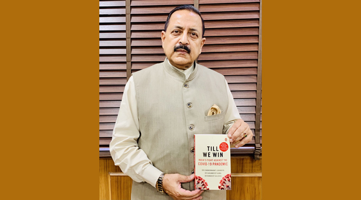 """Union Minister Dr Jitendra Singh displaying a medically documented book on India's Fight against COVID, while participating in a Virtual discussion on the occasion of """"Teeka Utsav"""", on Sunday."""