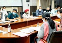 Div Com Jammu chairing a meeting.