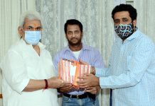 Lt Governor Manoj Sinha meeting with Film producer, Shiv Sagar and actor Sunil Lahri on Saturday.