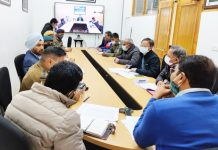 Divisional Commissioner Ladakh Saugat Biswas chairing a meeting.